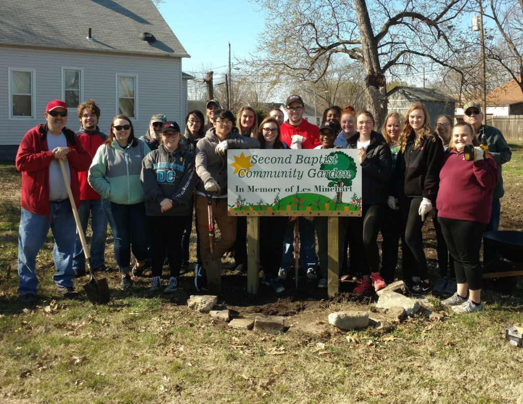 Jeff Rains is pictured with SIUE volunteers after installing the new sign in spring 2017.